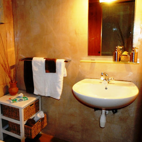 All of the rooms have en-suite bathrooms that continue the soft colour scheme.