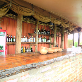 Outside, there is a large wooden bar made from local eucalyptus wood...