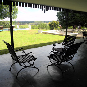 Outside there is a wide veranda with views of the South Luangwa National Park.