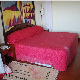 Bedrooms at the Serena are simple and colourful - they make a good base for a night
