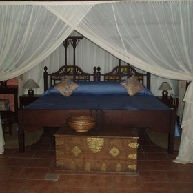 The bedrooms at Amani Beach are decorated using traditional Swahili furniture.